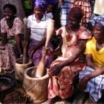 Crushing shea nuts with a pestle - Ghana, 2006